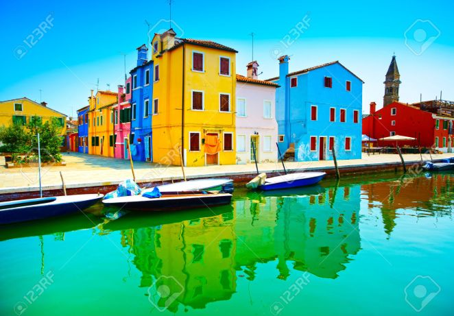 32465026-Venice-landmark-Burano-island-canal-colorful-houses-church-and-boats-Italy-Long-exposure-photography-Stock-Photo
